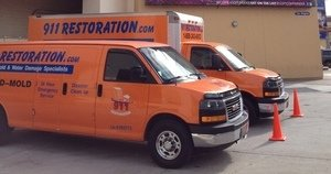 Water Damage Vans At Residential Job Location