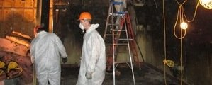 Sewage Removal Technicians Working In Basement